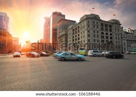 the street scene of the bund at dusk in shanghai,China. - stock photo