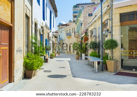 The streets of the old town decorated with plants in pots and colorful signboards, Limassol, Cyprus.
