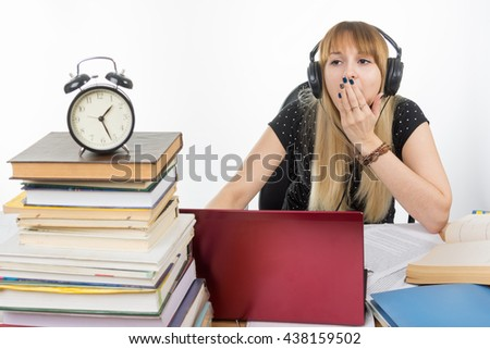 The student later dedicated the night yawns at his laptop - stock photo