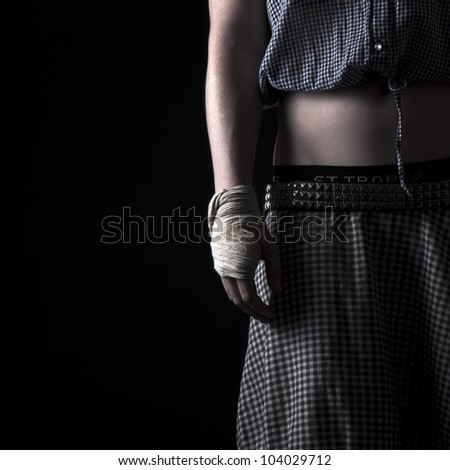 The studio portrait ot the woman with the injured wrist - stock photo