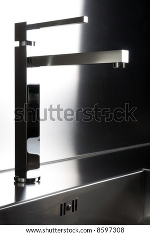 The stylish steel tap in the modern kitchen 2 - stock photo