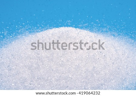 The sugar white sand shot close-blue background.
