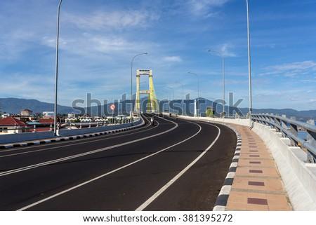 The Sukarno Bridge over the harbor in Manado, North Sulawesi, Indonesia - stock photo