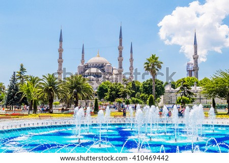 The Sultan Ahmed Mosque (Blue Mosque) and fountain view from the Sultanahmet Park in Istanbul, Turkey - stock photo