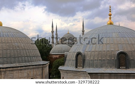 The Sultan Ahmed Mosque, more commonly referred to as the Blue Mosque, shot from Hagia Sofia.  Located in Istanbul, Turkey.  - stock photo