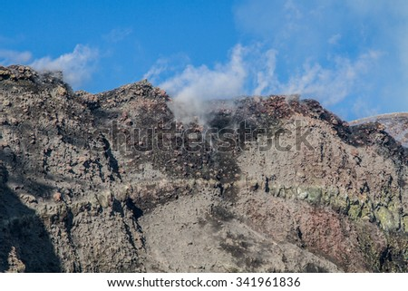 The summit craters of the Etna volcano erupting - stock photo
