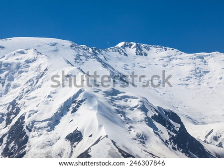 The summit of Leinin peak, view from camp 2, Pamir mountains, Kyrgyzstan - stock photo