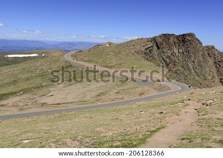 The summit road on Pikes Peak, famed Colorado 14er and site of the high altitude Road Race, The Pikes Peak International Hill Climb - stock photo