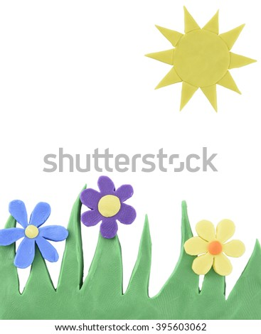 The sun and flowers made from plasticine - stock photo