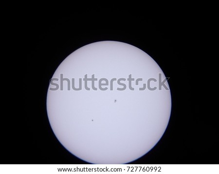 the sun and sunspots through an amateur telescope with solar filter