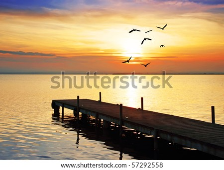 the sun and the pier - stock photo
