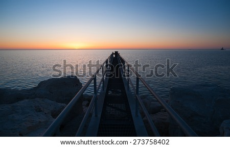 The Sun Comes up Over Lake Michigan Milwaukee Harbor - stock photo