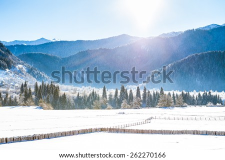 The Sun in the Valley of Caucasus Mountains - stock photo