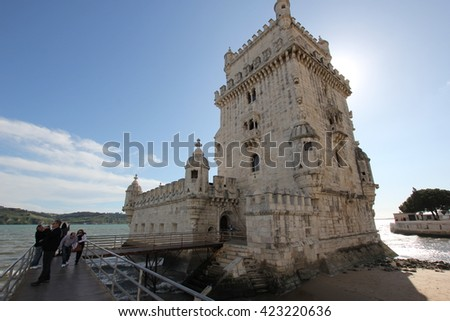 The sun is hiding behind Belem Tower - stock photo