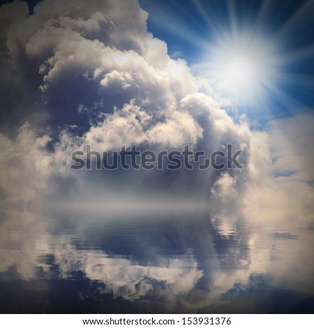 The sun on dramatic sky over sea. Natural background. Forces of nature concept.  - stock photo