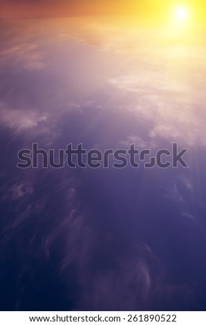 The sun rises above the clouds and bright rays. Breaking Dawn. natural composite - stock photo