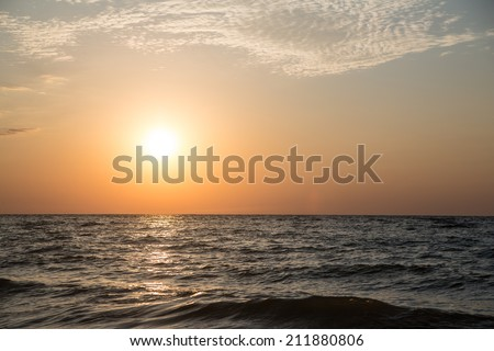 The sun rises over the sea. Summer - stock photo