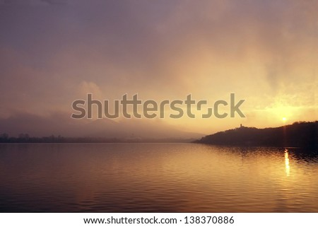 The sun rises over Xuanwu lake in Nanjing, China - stock photo