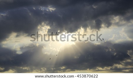 the sun's rays through the clouds