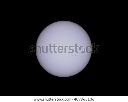 The Sun seen with telescope from planet Earth, with sunspots visible as dark spots compared to surrounding regions (Real photo with my own telescope, no NASA images used)
