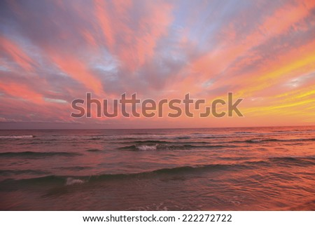 The Sun Sets in Pink and Orange on a Florida Beach - stock photo