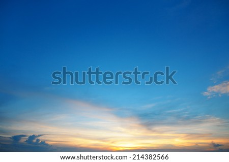 the sun sets in the clouds - stock photo