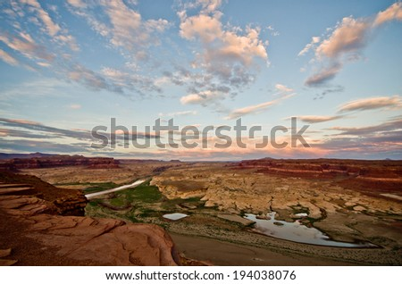 The sun sets over the Dirty Devil river at the north end of the Glen Canyon Recreation Area.