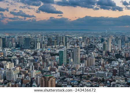 The sun sets over the sprawling cityscape of Tokyo. - stock photo