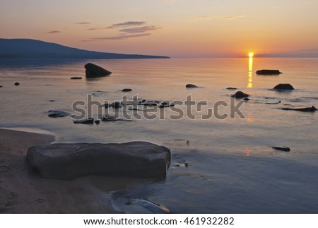 The sun sets over Union Bay in the Porcupine Mountains Wilderness State Park in Ontonagon County in Michigan's Upper Peninsula