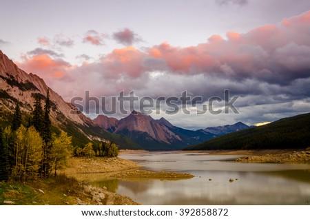 The sun setting on Medicine Lake in Jasper, Alberta - stock photo