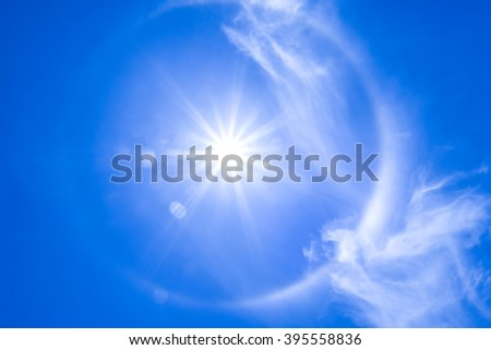 The sun shines bright in the daytime in summer. Blue sky and clouds