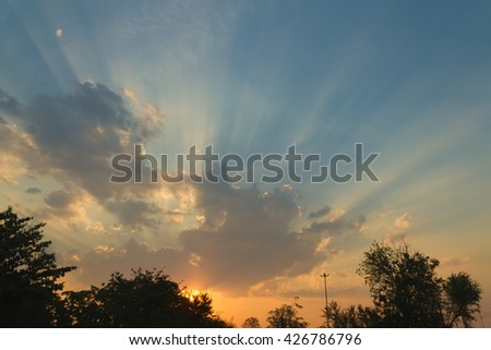 The sun shines bright in the daytime in summer. Blue sky and clouds. - stock photo