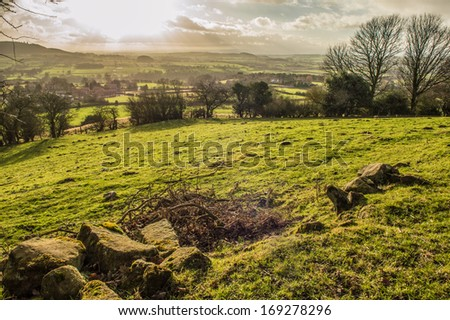 The sun shines over farmland in the North Yorkshire Moors  - stock photo