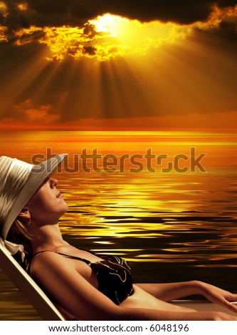 The sunbathing woman on background of  sunset - stock photo