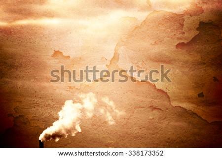 The sunlight illuminated smoky chimney of an industrial plant / Smoking chimney               - stock photo