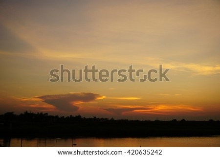 The sunset background with soft focus.The river side.