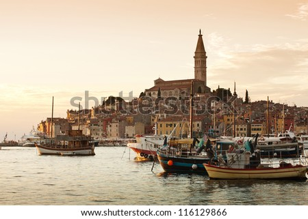 the sunset in old city Rovinj with boats - Croatia - stock photo