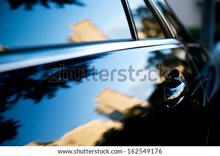 The sunset is reflected  in the brand new car - stock photo