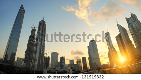The sunset on the modern building background in shanghai china - stock photo