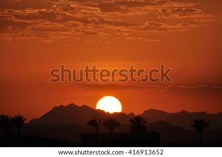 The sunset over the mountains of the Sinai Peninsula Sharm El-Sheikh . Egypt