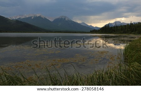 The sunset reflecting in the Vermilion lakes.  Located in Banff National Park, Alberta, Canada.  - stock photo
