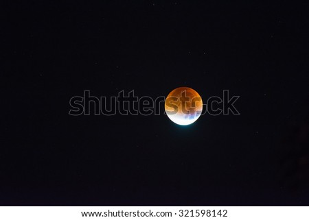 The supermoon lunar eclipse of September 28, 2015 in Paris sky. A rare supermoon combines with a lunar eclipse for the first time since 1982. - stock photo