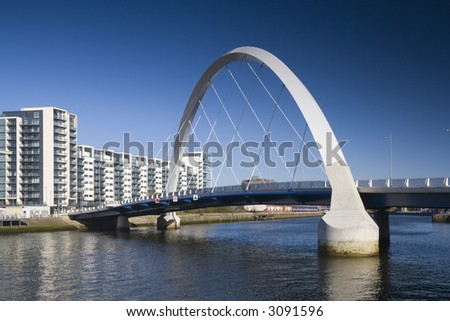 The supporting arch of the Clyde Arc bridge in Glasgow, Scotland, against a blue sky - stock photo