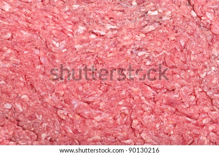 The surface of raw ground beef showing the fatty tissue.