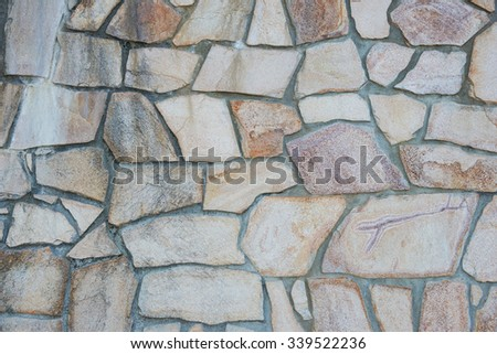 The surface of the stone wall background - stock photo