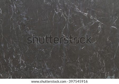 the surface texture of marble pietra grey dark gray marble with a brown tint excised brown dark gray