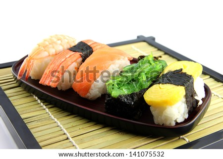 The Sushi on the dish and Sushi is a food of Japanese.