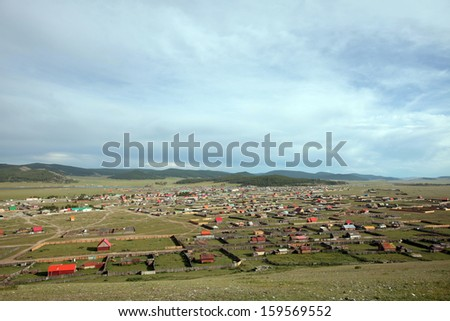 The sweeping remote hills of Mongolia are marked only by primitive roads and clusters of simple cabins.