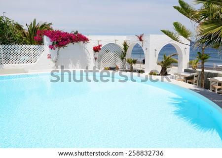 The swimming pool at luxury hotel, Santorini island, Greece - stock photo