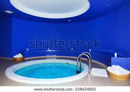 The swimming pool in SPA at modern hotel, Santorini island, Greece - stock photo